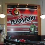 Ottawa Signs - Team 1200 Broadcast Booth Panel Installation